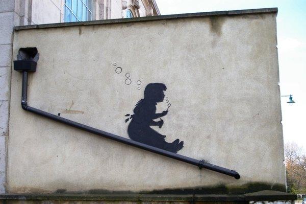 Banksy Drainpipe on Lower Clapton Road, London